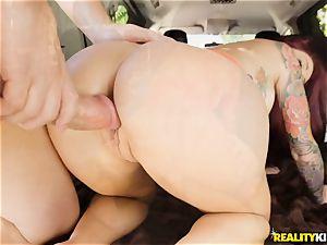 Monique Alexander blows a fat manstick in the car