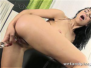 buxomy Elena Rae pees through her pantyhose