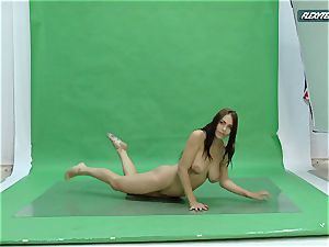 hefty bra-stuffers Nicole on the green screen spreading
