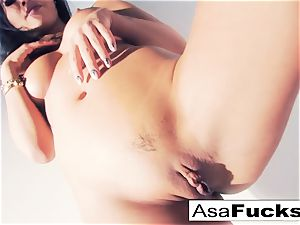Asa Akira uses a fake palm to sate her cunt